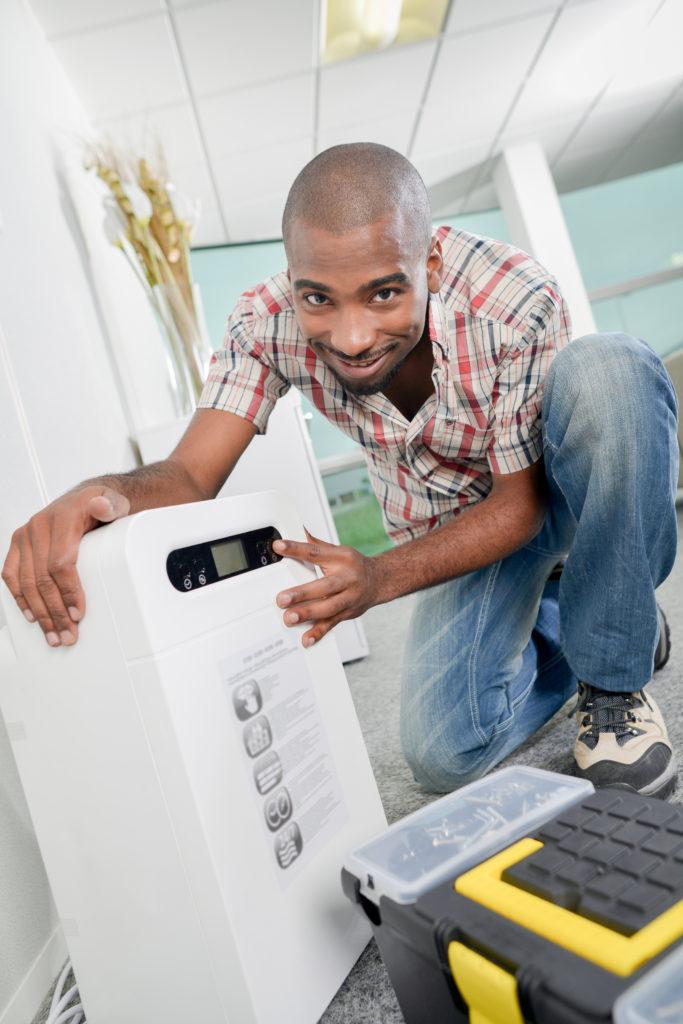 Man installing a dehumidifier