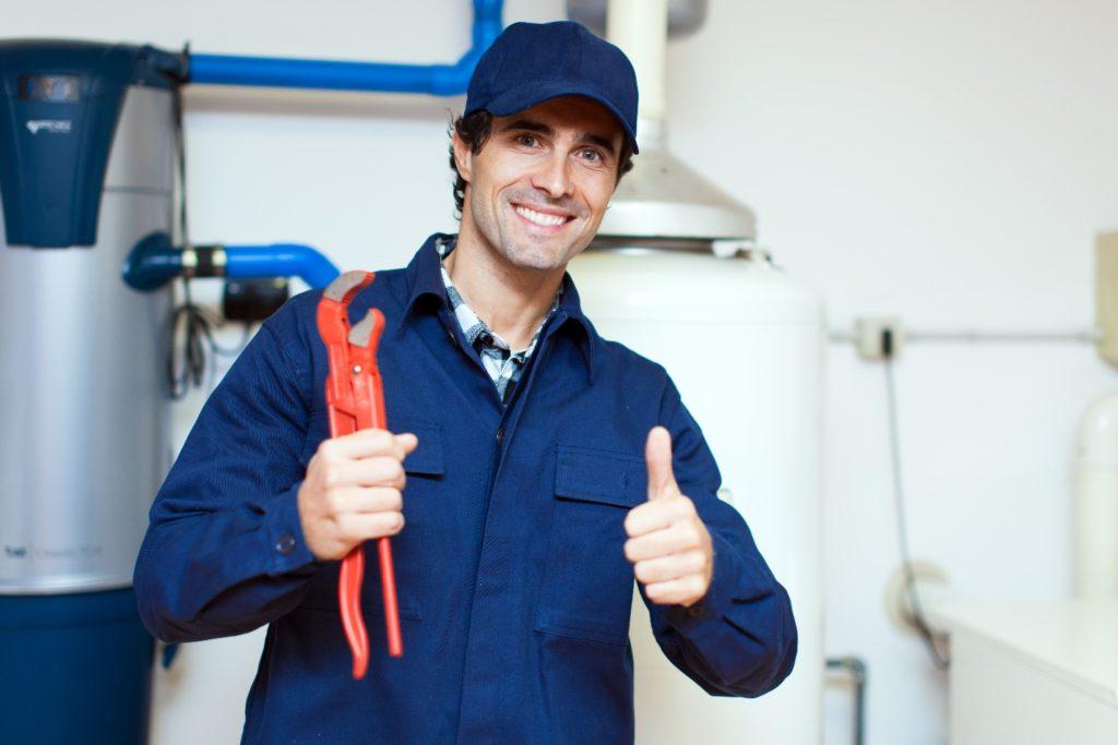 plumber smiling at the camera