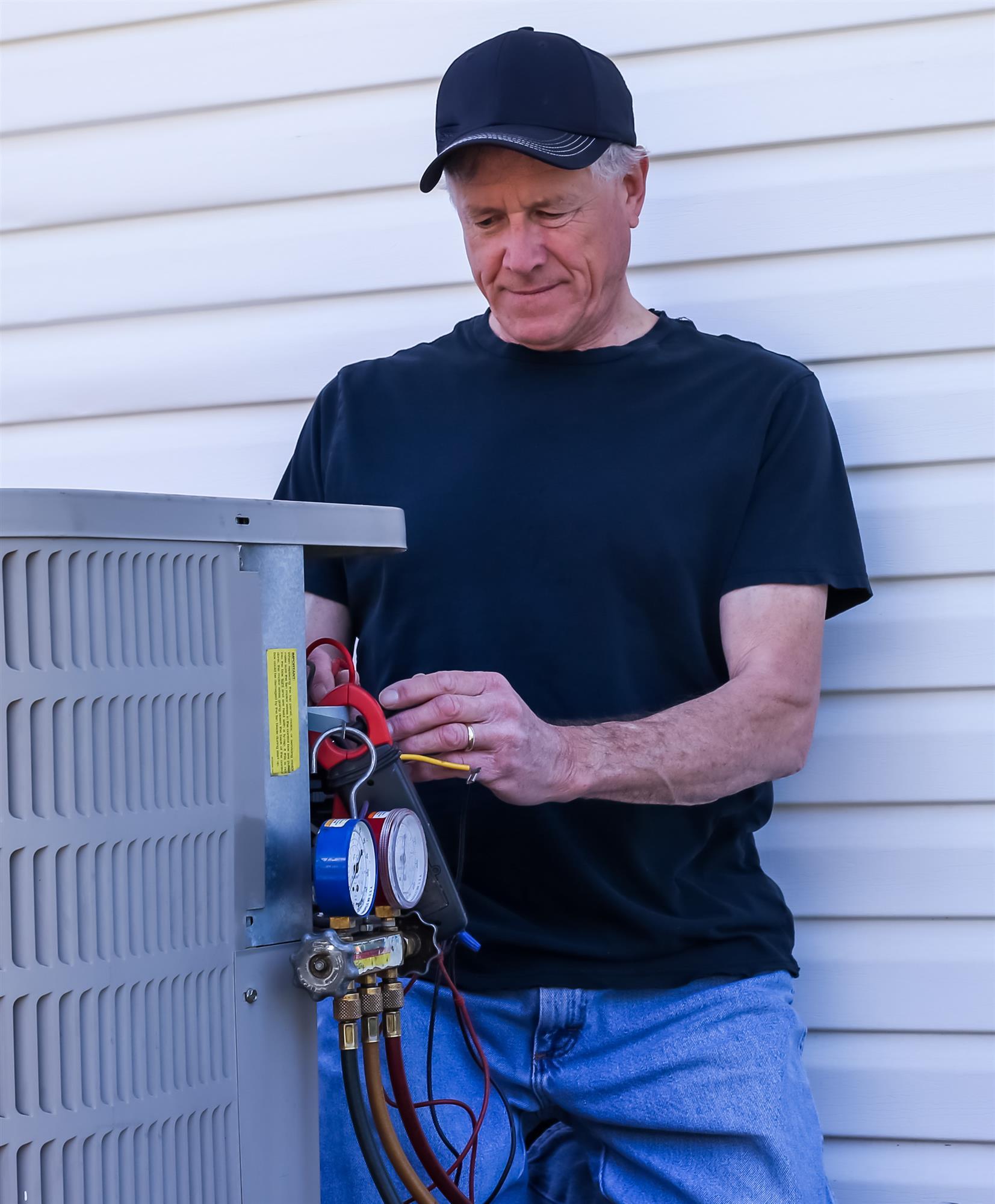 plumber repairs furnace