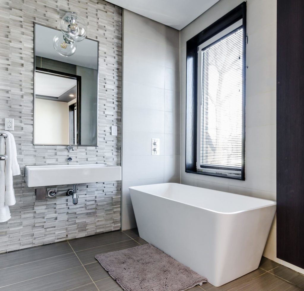 bathroom sink with mirror above and towels