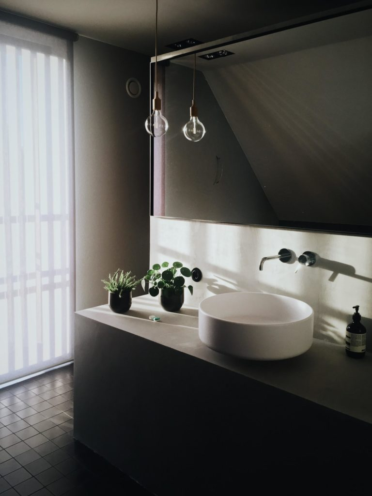 white ceramic sink and natural light