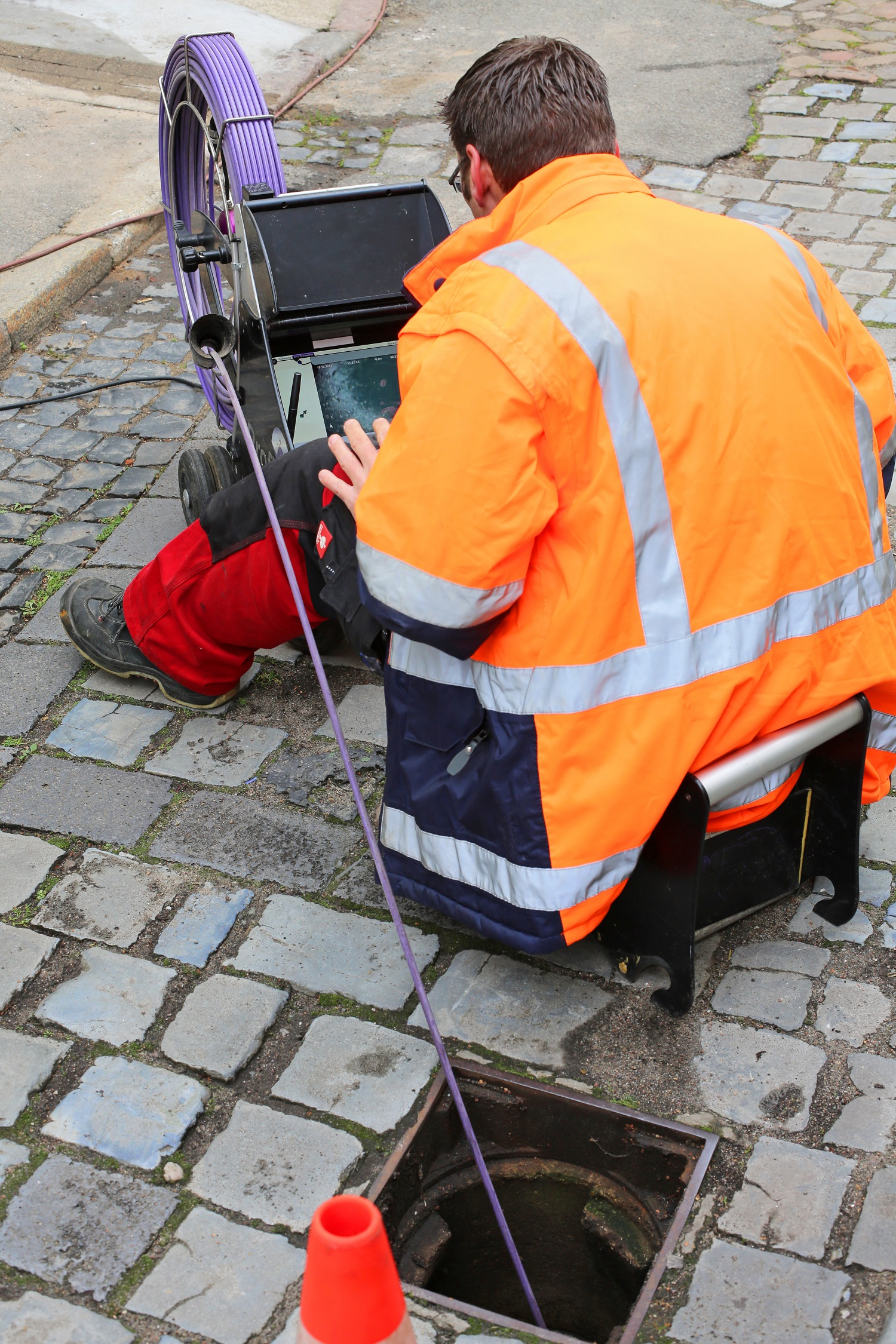 plumber using a sewer camera for inspections
