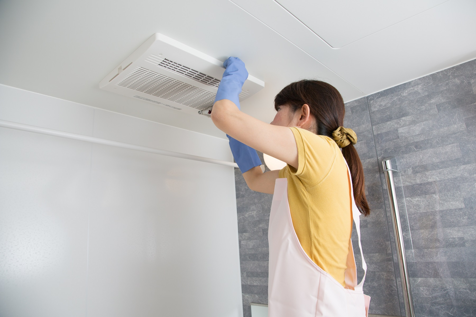 woman housekeeping ventilation cleaning