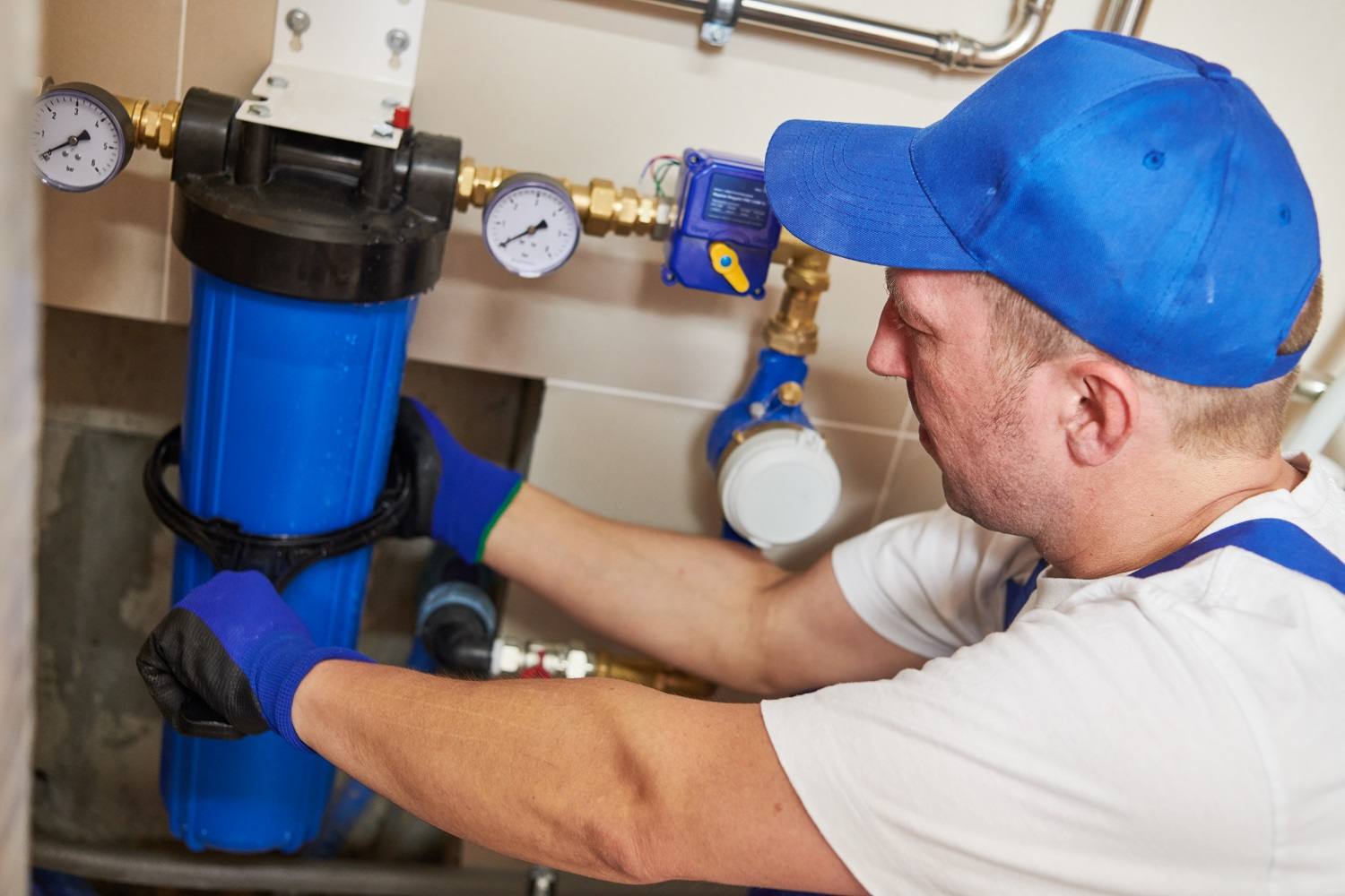 plumber Installing water filter into system