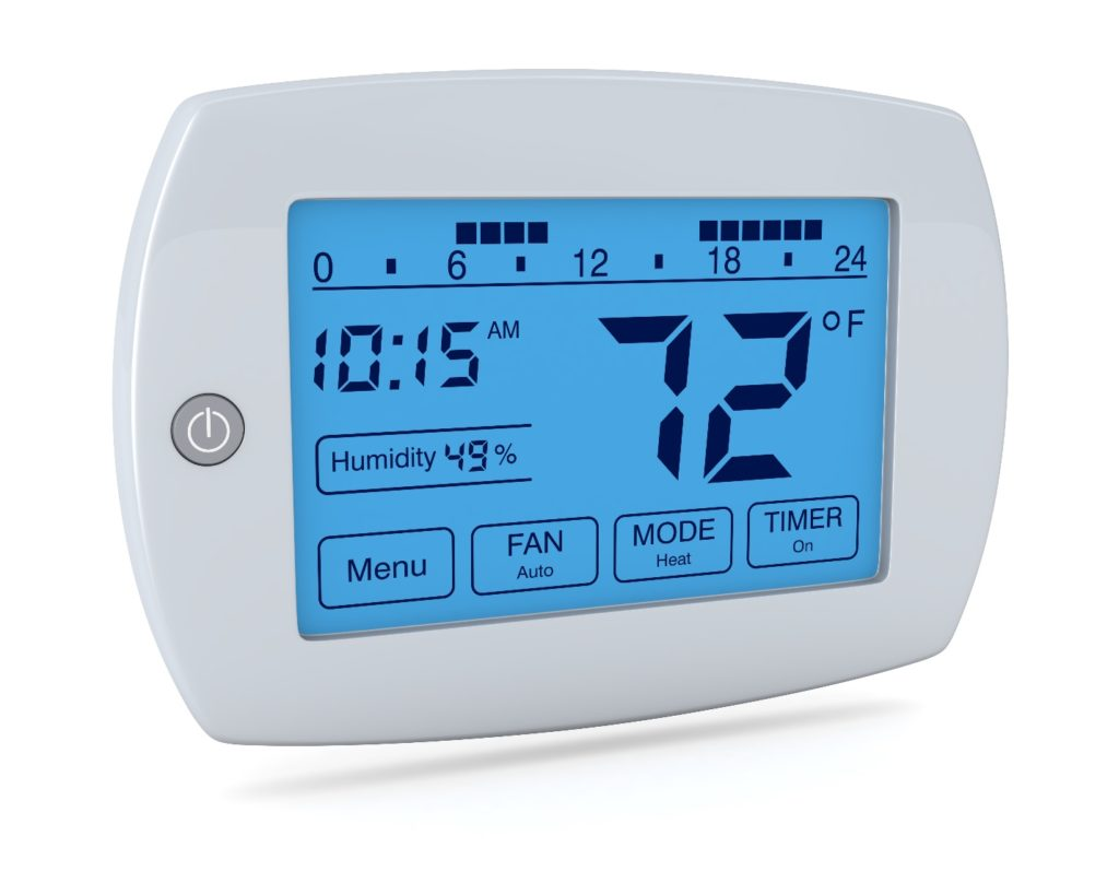 closeup of a digital, programmable thermostat