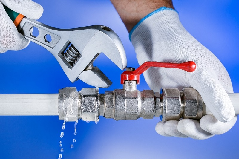 Hands plumber at work in a bathroom, plumbing repair service