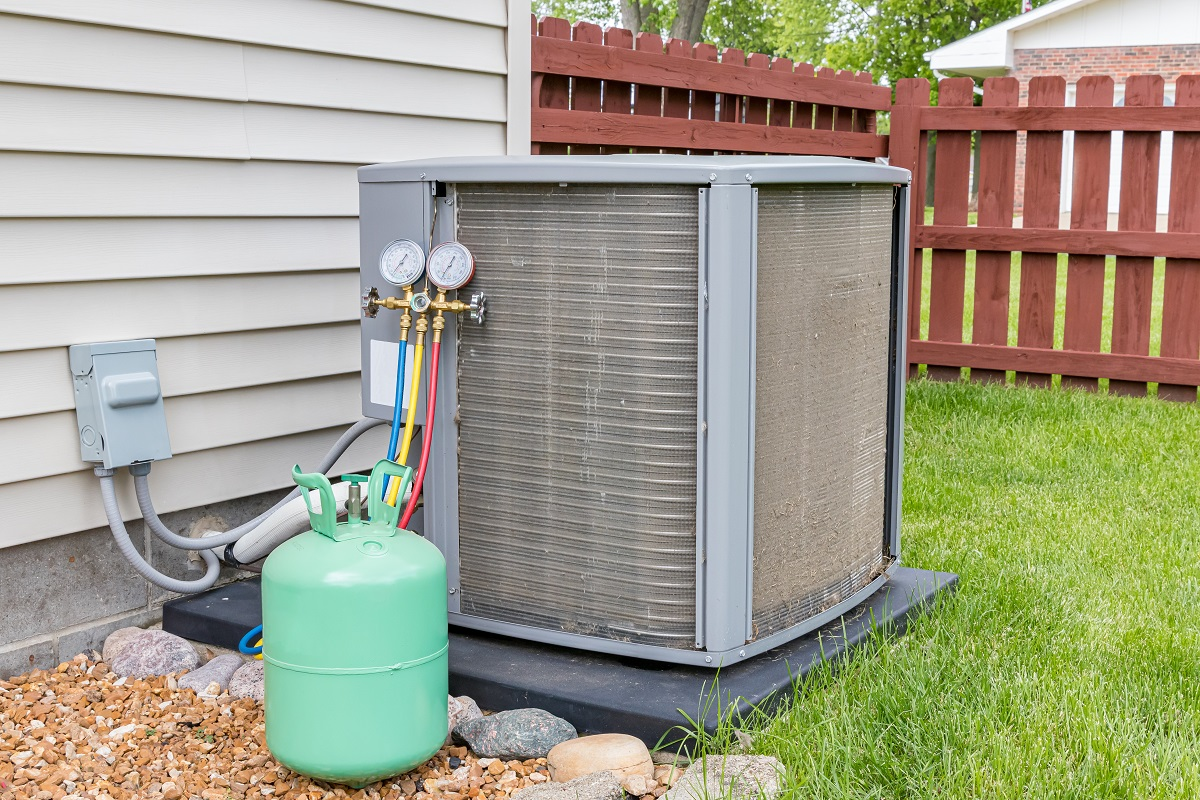 Dirty air conditioning unit. Condenser coils full of dirt and grass debris