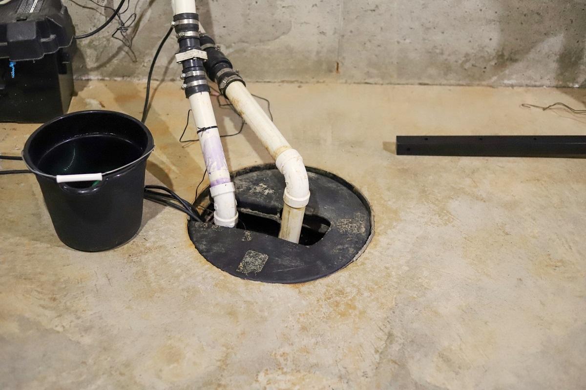 A sump pump in a home basement-plumbing repair