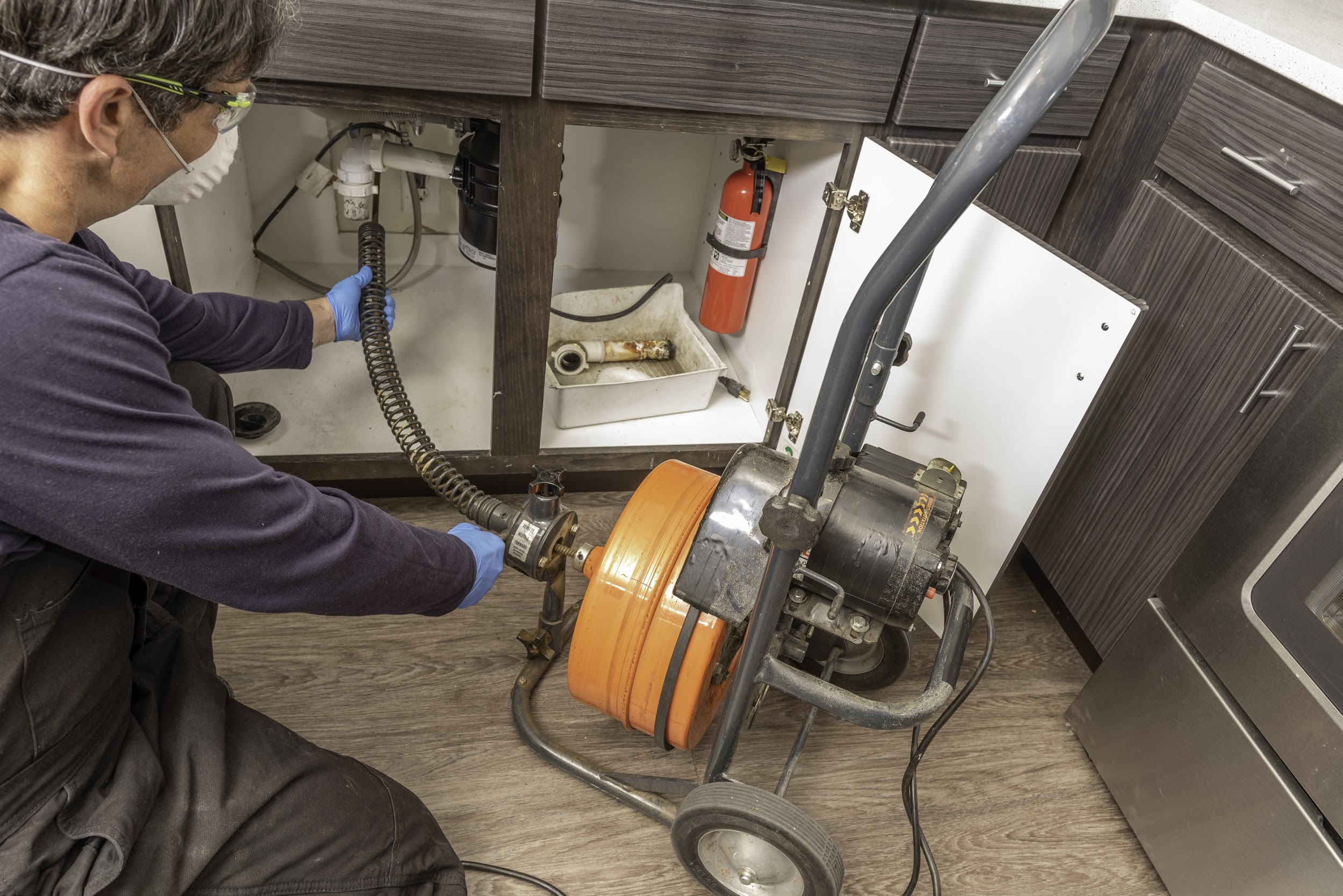 Professional drain cleaning with a self guiding electric snake