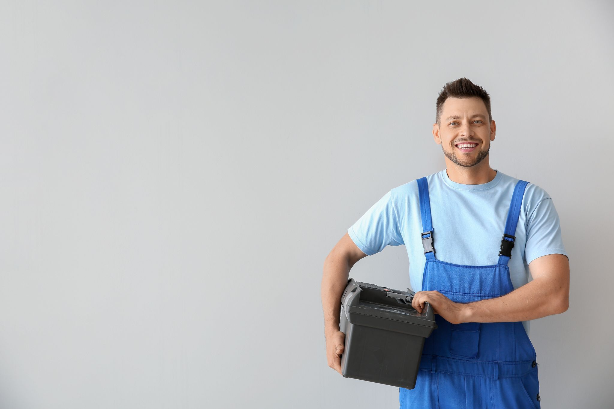 handsome plumber with tools box