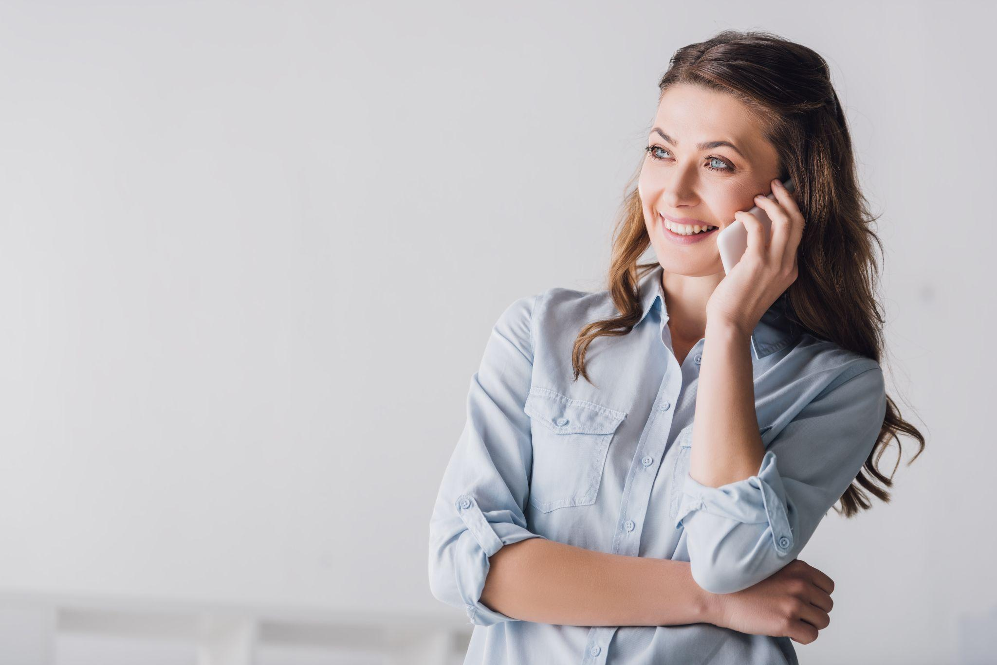smiling adult woman talking on phone